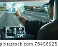 truck driver searching location on digital map. 76456925