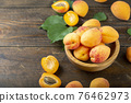 Delicious ripe apricots and leaves 76462973