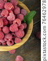 Fresh raspberry in wooden bowl. The berry is rich in vitamins. 76462978