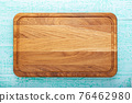 Multifunctional wooden chopping board for cutting bread, pizza or steak on wood background 76462980