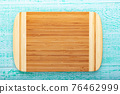 Multifunctional wooden chopping board for cutting bread, pizza or steak on wood background 76462999
