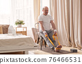 Man sitting on chair doing paschimottanasana or Intense Dorsal Stretch pose 76466531