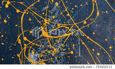 abstract oil color yellow color splatter paint on dark blue texture background. color paint texture background design 76468513