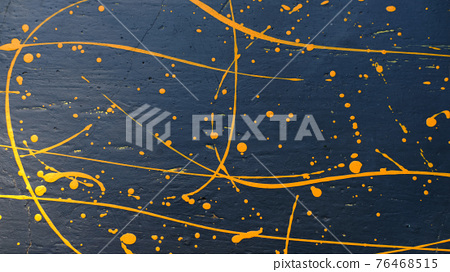 abstract oil color yellow color splatter paint on dark blue texture background. color paint texture background design 76468515