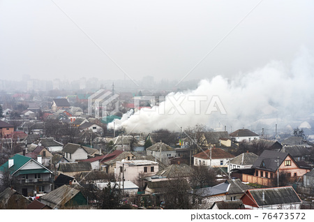 Top view of the area in which a residential building is on fire. Fire in the private housing sector 76473572