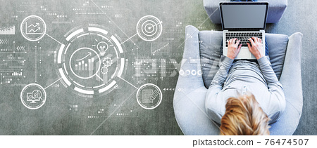 Data Analysis concept with man using a laptop 76474507