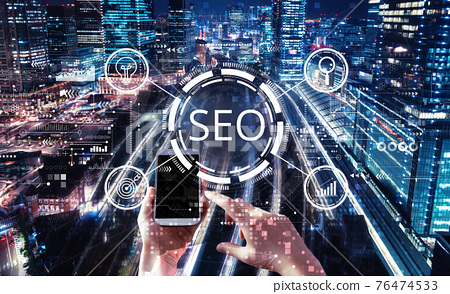 SEO concept with person using smartphone 76474533