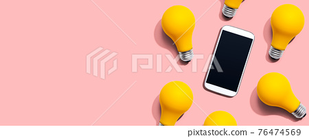 Smartphone with yellow light bulbs 76474569