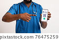 Black doctor showing cellphone with digital e-passport for covid-19 76475259