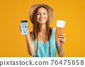 Tourist showing smartphone with Immune digital passport for covid-19 76475658