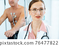Doctor and patient during stress or exercise ecg 76477822