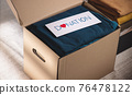 Clothes Donation Concept. Box of Cloth with Donate label. Preparing Used Old Garment at Home. Top View 76478122