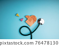 Health Care Concept. International World Heart Day. Wooden Jigsaw as Heart Shape with Stethoscope lay on Blue background. Life, Love and Care. Top View 76478130