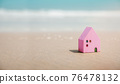 Beach House Concept. Mini Colorful Wooden House on the Sand Beach. Destination for Vacation or Retirement Life. Summer Sunny Day. Metaphor Photo 76478132