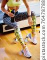 Torso of slim attractive female with protein shake in sportswear 76478788