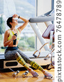 attractive fitness woman tired after workout drinks protein shake 76478789