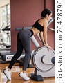 attractive athletic woman glutes legs workout in gym 76478790