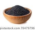 black sesame seeds in wooden bowl isolated 76479796