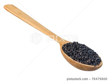 dry black sesame seeds in wooden spoon 76479800