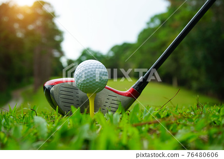 Golf ball and golf club in beautiful golf course at Thailand. Collection of golf equipment resting on green grass with green background 76480606