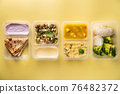 containers with healthy food 76482372