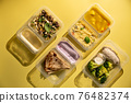 containers with healthy food 76482374