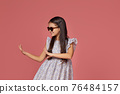 little child girl in summer dress and sunglasses 76484157