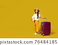 Happy little child girl in hat with pink suitcase 76484185