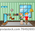 Parents couple with little baby in living room 76492693