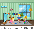 Happy children playing in the living room 76492696