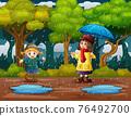 Happy girls playing in the rain 76492700