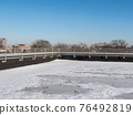 Snow at the roof top 76492819