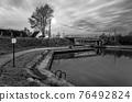 River with a bridge 76492824