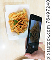 Asian Women Hand Take Pictures Of Food For Social Media Use. 76497240