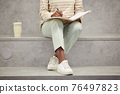 Female Student Writing Notes in College 76497823