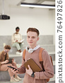 Teenage Young Man in College 76497826