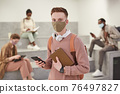 Portrait of Student Wearing Mask in College 76497827