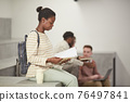 Young African American Woman Reading Notes in College 76497841