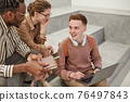 Group of Students Chatting in College 76497843