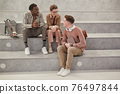 Young Students Chatting in College 76497844