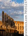 Via Sacra Columns and Colosseum at Sunset 76503237