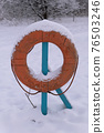 Lifebuoy On River Shore In Winter 76503246