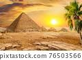 Pyramids and sun 76503566
