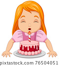 Happy girl blowing candles of birthday cake 76504051