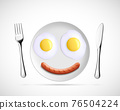 Fried eggs with sausage in the form of a smiley 76504224