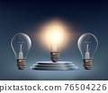 Light bulb standing on the winners podium. 76504226
