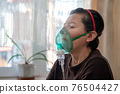 Close-up photo of sick caucasian woman with an inhaler. Unhealthy female doing inhalation at home, Inflammatory lung disease. 76504427