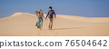 BANNER, LONG FORMAT Happy couple healthy lifestyle affectionate outdoors in nature during hiking travel. Man and woman hikers smiling in mountain desert landscape. Tourism opens after quarantine COVID 76504642