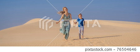 Mother and son in the desert. Traveling with children concept. Tourism reopens after quarantine COVID 19 BANNER, LONG FORMAT 76504646