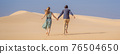 BANNER, LONG FORMAT Happy couple healthy lifestyle affectionate outdoors in nature during hiking travel. Man and woman hikers smiling in mountain desert landscape. Tourism opens after quarantine COVID 76504650